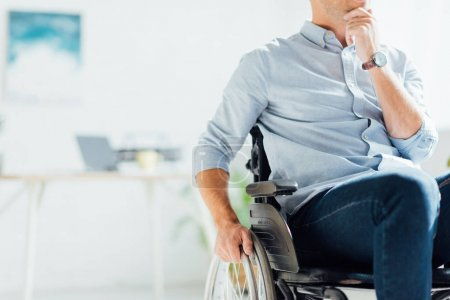 Photo for Cropped view of pensive man in wheelchair with hand on chin - Royalty Free Image
