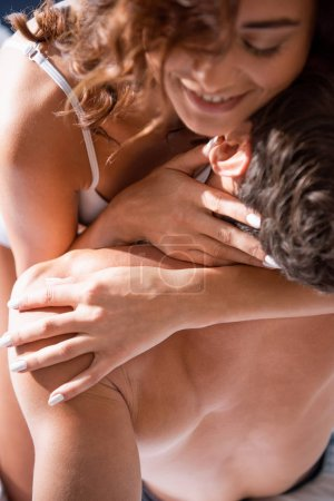 Photo for High angle view of smiling girlfriend hugging with boyfriend - Royalty Free Image