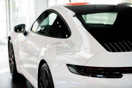 Photo for KYIV, UKRAINE - OCTOBER 7, 2019: selective focus of modern white porshe in car showroom - Royalty Free Image