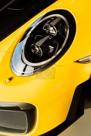 Photo for KYIV, UKRAINE - OCTOBER 7, 2019: close up of headlight of luxury yellow porshe - Royalty Free Image