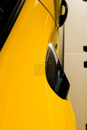 Photo for KYIV, UKRAINE - OCTOBER 7, 2019: top view of yellow luxury porshe in car showroom - Royalty Free Image