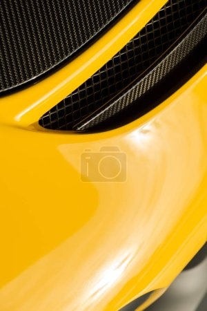 KYIV, UKRAINE - OCTOBER 7, 2019: selective focus of metallic car grill in new yellow porshe