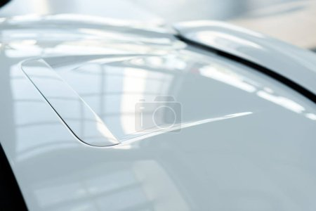 KYIV, UKRAINE - OCTOBER 7, 2019: close up of new shiny and white porshe
