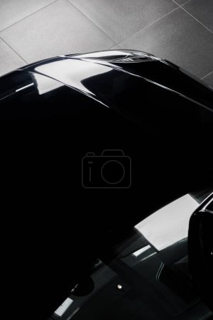 KYIV, UKRAINE - OCTOBER 7, 2019: top view of black and shiny porshe in car showroom