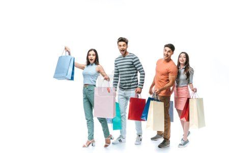 Photo for Excited friends walking with shopping bags together, isolated on white - Royalty Free Image