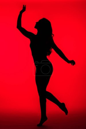 Photo for Black silhouette of sexy woman on red - Royalty Free Image