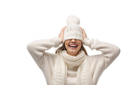attractive laughing woman warming up in white knitted hat, isolated on white
