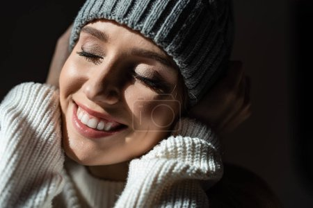 Photo for Portrait of beautiful smiling girl in sweater and hat - Royalty Free Image