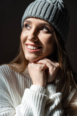portrait of beautiful happy woman in sweater and hat