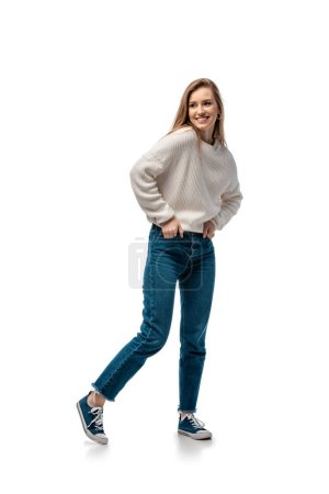 Photo for Beautiful smiling woman in jeans and white sweater, isolated on white - Royalty Free Image