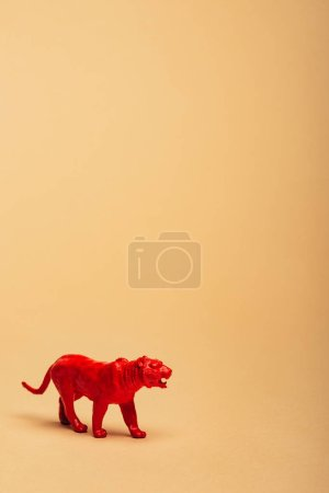 Photo pour Red toy tiger on yellow background, animal welfare concept - image libre de droit