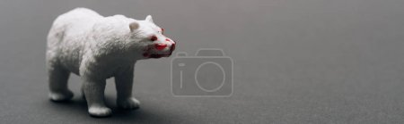 Photo pour Panoramic shot of white toy bear with blood on grey background, killing animals concept - image libre de droit