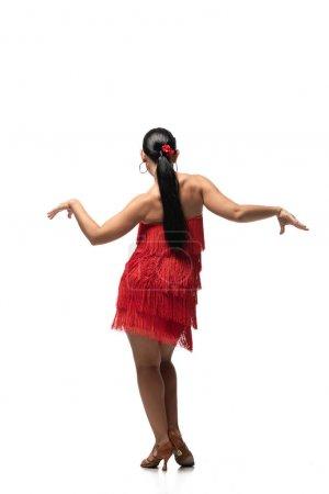 Photo pour Vue arrière du danseur passionné en robe élégante avec frange exécutant tango sur fond blanc - image libre de droit
