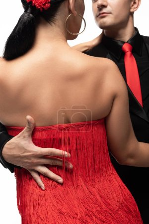 Photo pour Cropped view of dancer hugging partner while performing tango isolated on white - image libre de droit