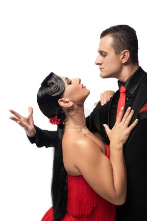 Photo pour Passionate dancers looking at each other while performing tango isolated on white - image libre de droit