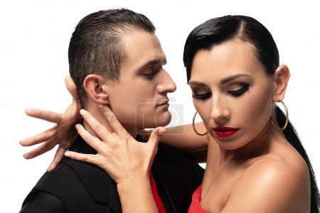 Photo pour Passionate dancer touching neck of sensual partner while performing tango isolated on white - image libre de droit