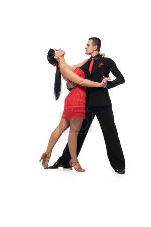 Photo pour Danseurs sensuels et élégants exécutant le tango sur fond blanc - image libre de droit