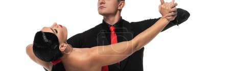 Photo pour Vue recadrée du danseur élégant exécutant le tango avec le beau partenaire isolé sur blanc, plan panoramique - image libre de droit