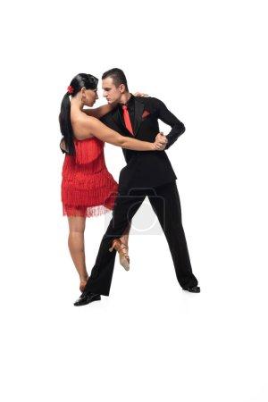 Photo pour Danseurs élégants et expressifs exécutant le tango sur fond blanc - image libre de droit