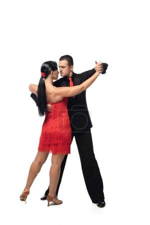 Photo pour Couple expressif et élégant de danseurs se produisant sur fond blanc - image libre de droit