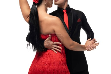 Photo for Cropped view of elegant dancers performing tango isolated on white - Royalty Free Image