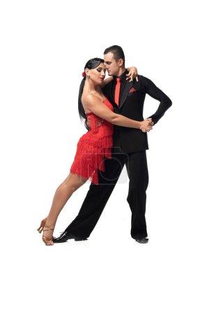Photo pour Couple passionné de danseurs exécutant le tango sur fond blanc - image libre de droit