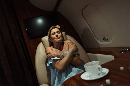 Photo for Selective focus of terrified woman sitting in private plane - Royalty Free Image