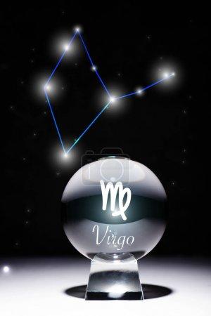 Photo pour Crystal ball avec Virgo zodiac signe isolé sur noir avec constellation - image libre de droit
