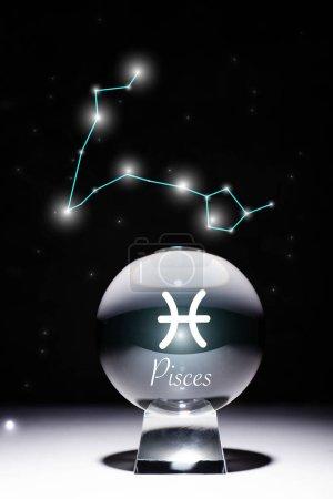 Photo pour Cristal ball avec signe de Pisces zodiac isolé sur noir avec constellation - image libre de droit
