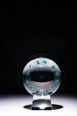 Foto de Crystal ball with zodiac signs isolated on black - Imagen libre de derechos