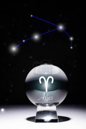 Photo pour Crystal ball with Aries zodiac sign isolated on black with constellation - image libre de droit