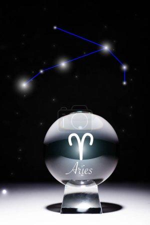 Photo pour Cristal ball avec signe zodiaque du Bélier isolé sur noir avec constellation - image libre de droit