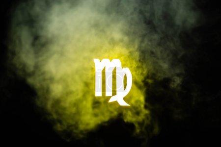 Photo pour Signe du zodiaque Vierge illuminé jaune avec fumée sur le fond - image libre de droit