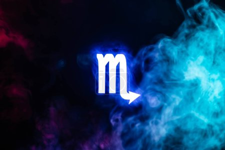 Photo pour Blue illuminated Scorpio zodiac sign with colorful smoke on background - image libre de droit