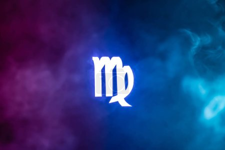 Photo pour Blue illuminated Virgo zodiac sign with colorful smoke on background - image libre de droit