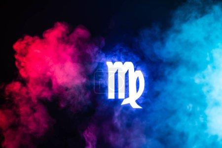 blue illuminated Virgo zodiac sign with colorful smoke on background