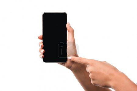 Photo for Cropped view of woman pointing with finger at smartphone with blank screen isolated on white - Royalty Free Image