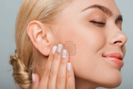 Photo pour Attractive woman with blush on cheek isolated on grey - image libre de droit