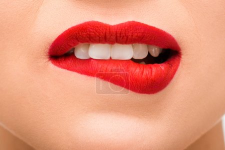 Photo for Cropped view of sexy young woman with red lipstick biting lips - Royalty Free Image
