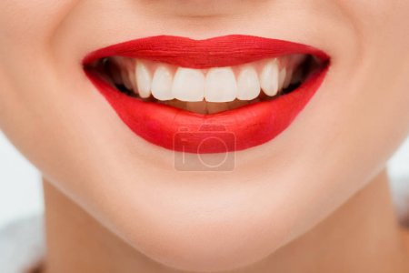 Photo pour Cropped view of happy young woman with red lipstick - image libre de droit