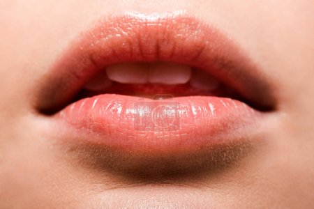 Photo for Close up of woman with shiny lip gloss on lips - Royalty Free Image