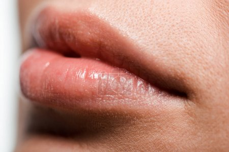 Photo for Close up of girl with shiny lip gloss on lips - Royalty Free Image