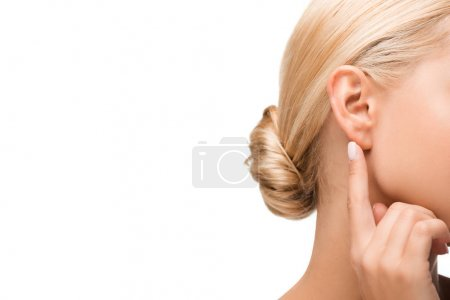 Photo for Cropped view of blonde girl pointing with finger at ear isolated on white - Royalty Free Image