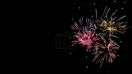 Photo for Colorful festive fireworks in night sky, isolated on black - Royalty Free Image