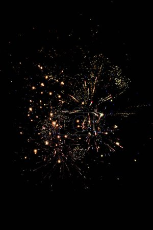 Photo for Traditional orange fireworks in dark night sky, isolated on black - Royalty Free Image