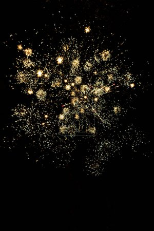 Photo for Many golden fireworks in dark night sky, isolated on black - Royalty Free Image
