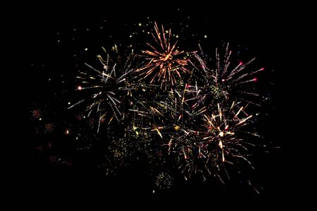 Photo for Traditional festive fireworks in dark night sky, isolated on black - Royalty Free Image