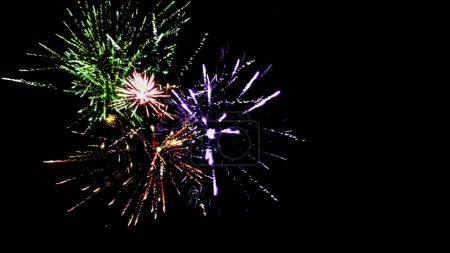 Photo for Colorful traditional fireworks in dark night sky, isolated on black - Royalty Free Image