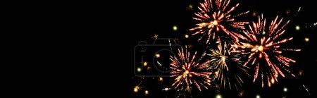 Photo for Panoramic shot of traditional red fireworks in dark night sky, isolated on black - Royalty Free Image
