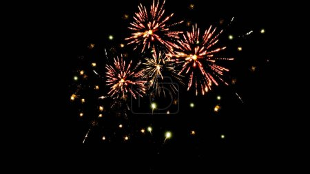 Photo pour Traditional orange fireworks in dark night sky, isolated on black - image libre de droit
